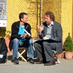 Turbo Pascal co-founder Frank Oberhaeusser interviewing a Littenweiler resident outside of the mobile archive. Photo Credit: Veit Merkle.