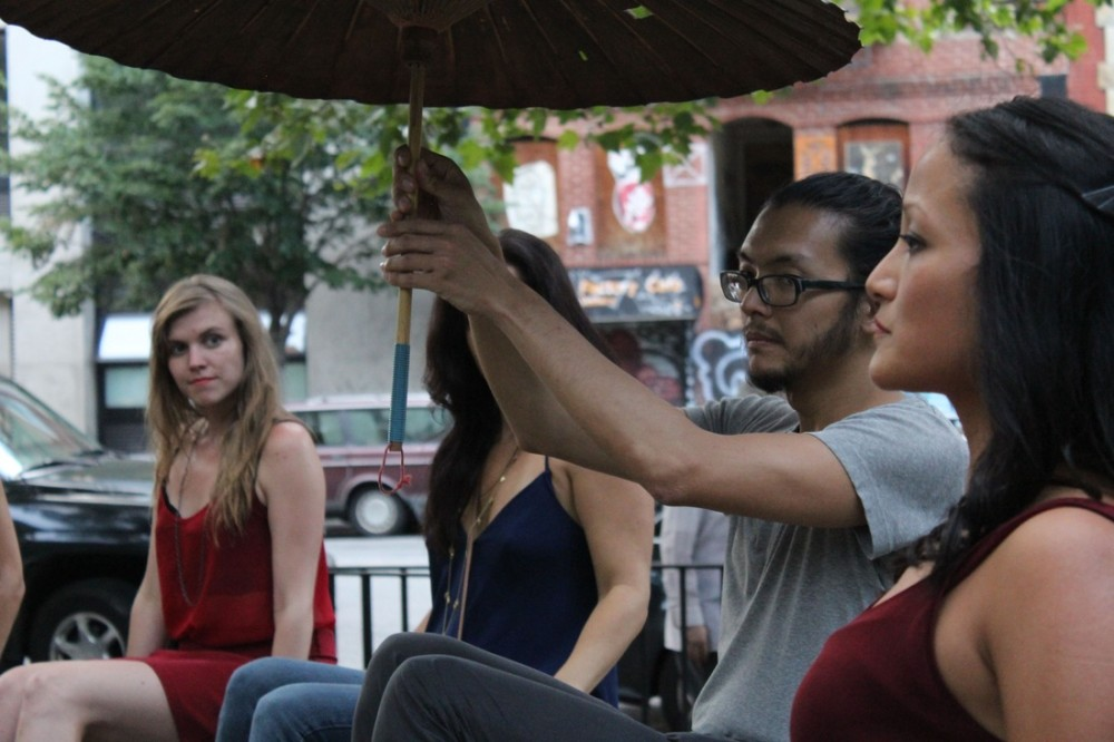 """An audience member takes over for an actor in """"Broken City: Lower East Side."""" Photo Credit: Ana Margineanu."""