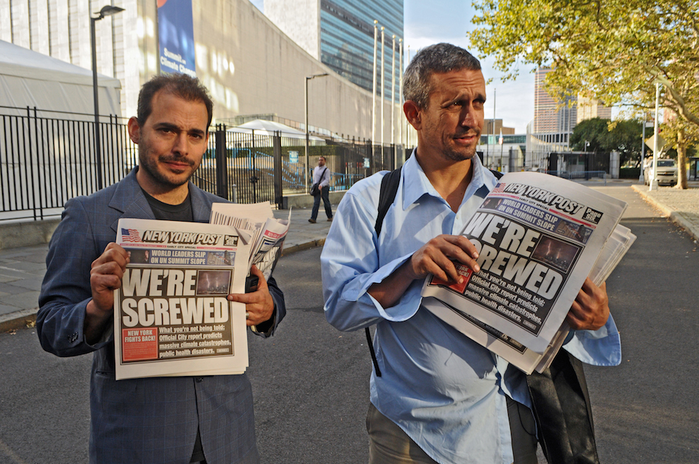 Mike Bonanno and Andy Bichlbaum (aliases of Igor Vamos and Jacques Servin , respectively) holding copies of a fake edition of the New York Post. Photo Credit: Genevieve Jacobson.
