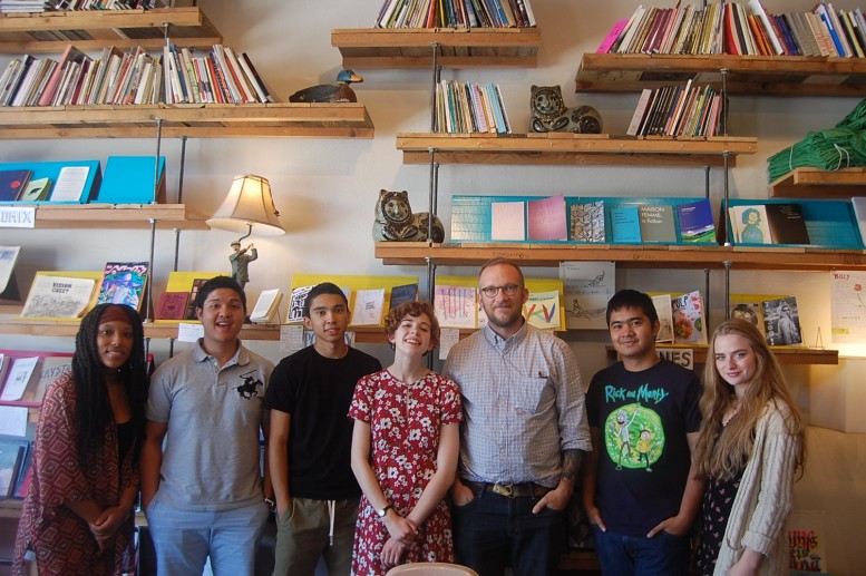 Noel Black, Alt Writer, at his bookstore, Mountain Fold Books in downtown Colorado Springs with members of American Theater Company's Youth Ensemble, (l-r) Lawren Carter, Michael Sandoval, Matt Gomez Hidaka, Olivia Shine, Noel Black, Max Dizon & Madison Pullman. Photo Credit: Lyla Whedbee