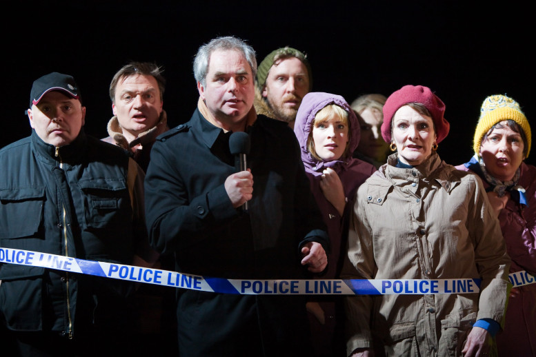 "The cast of the original production of ""London Road"" at the National Theatre in London. Left to right: Nick Holder, Hal Fowler, Howard Ward, Paul Thornley, Rosalie Craig, Nicola Sloane and Claire Moore. Photo Credit: Helen Warner."