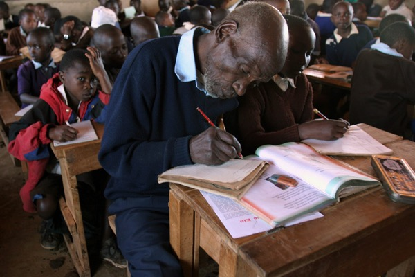 Kimani Ng'ang'a Maruge at his school desk
